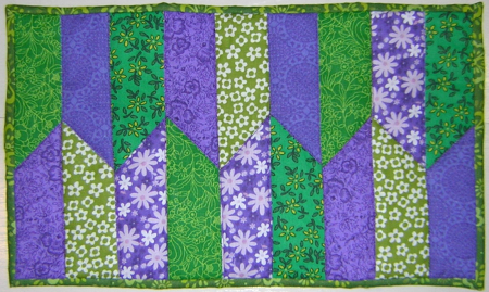Purple and green mug rug